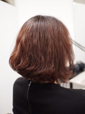 クセ毛の女性